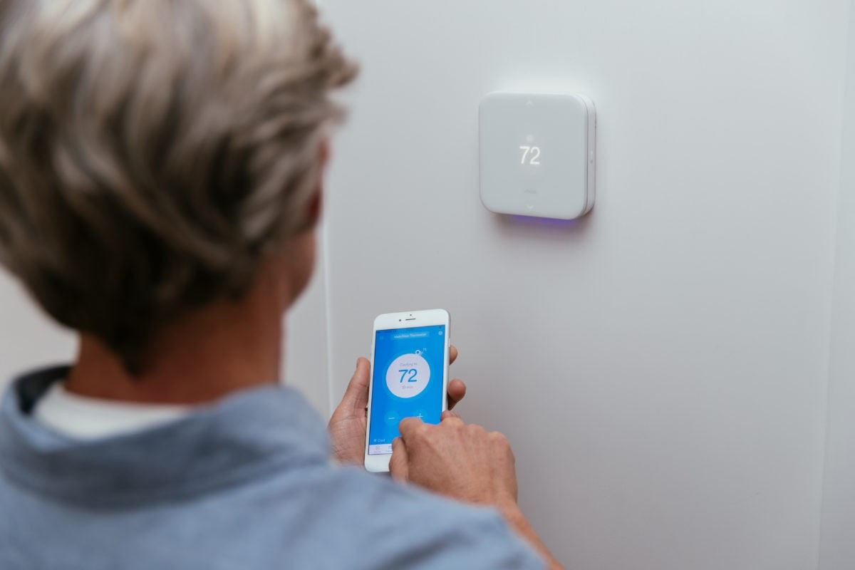 Vivint mobile app being used to control Vivint thermostat